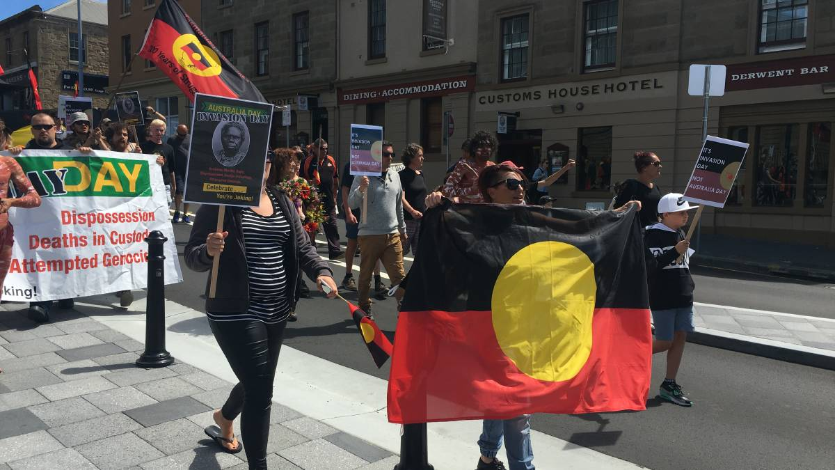 Protesters walk through the streets of Hobart at an Invasion Day rally in 2017.